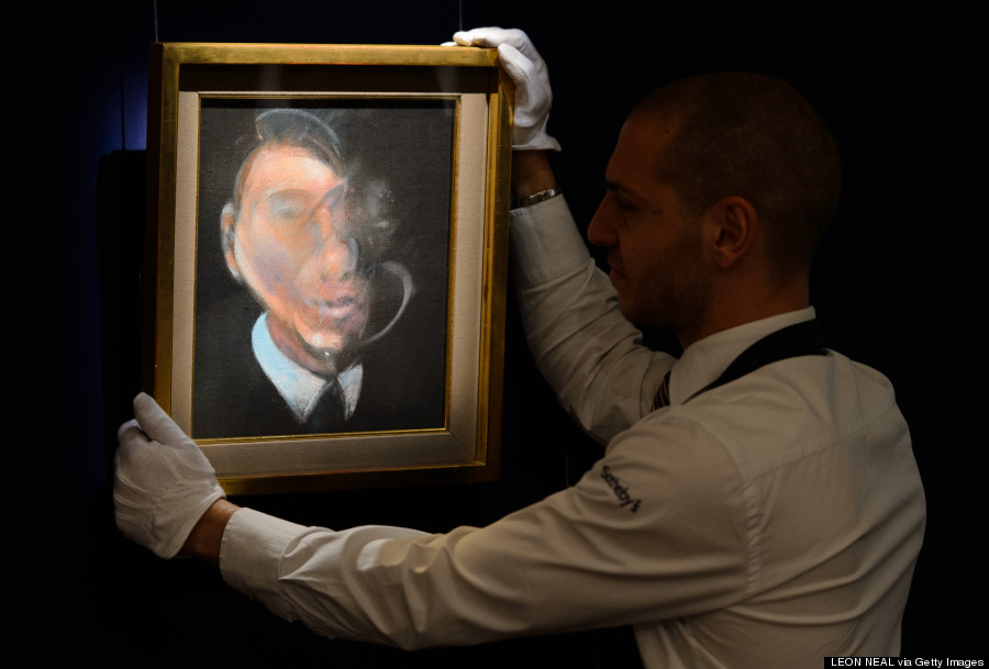 A gallery assistant poses with British artist and scientist Francis Bacon's 'Study for Self-Portrait, 1980' at Sotheby's acution house in central London on June 14, 2012. (LEON NEAL/AFP/GettyImages)